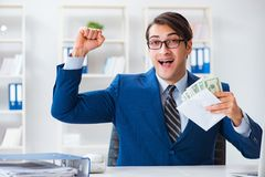 The businessman receiving his salary and bonus. Businessman receiving his salary and bonus stock photos