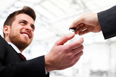 Businessman receiving a key Royalty Free Stock Photo