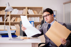 The businessman receiving letter envelope in office Stock Photos