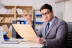 The businessman receiving letter envelope in office Stock Photo