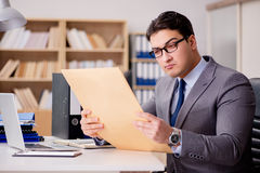 The businessman receiving letter envelope in office Royalty Free Stock Image