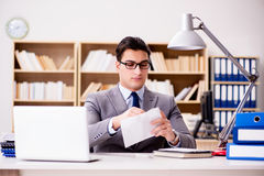 The businessman receiving letter envelope in office Stock Images