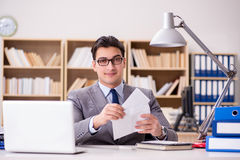 The businessman receiving letter in the office Royalty Free Stock Photo