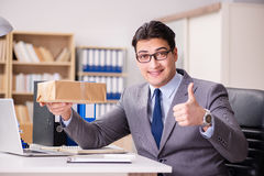 The businessman receiving parcel in the office Stock Photos
