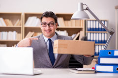 The businessman receiving parcel in the office Royalty Free Stock Images
