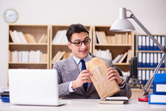 The businessman receiving parcel in the office Stock Photo