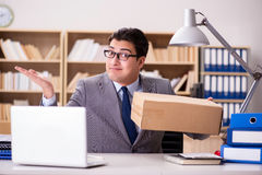 The businessman receiving parcel in the office Stock Images