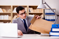 The businessman receiving parcel in office Royalty Free Stock Image