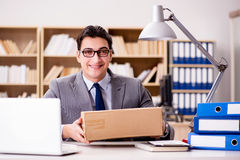 The businessman receiving parcel in office Stock Image