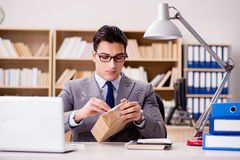 The businessman receiving parcel in office Stock Photography