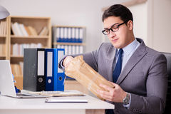 The businessman receiving parcel in the office Royalty Free Stock Photography