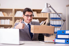 The businessman receiving parcel in the office Royalty Free Stock Photos