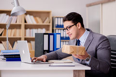 The businessman receiving parcel in office Royalty Free Stock Images