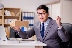 The businessman receiving parcel in office Royalty Free Stock Photo