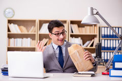The businessman receiving parcel in the office Stock Photography