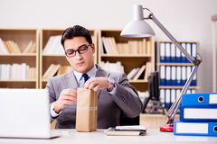 The businessman receiving parcel in office Stock Photos