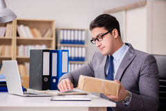 The businessman receiving parcel in the office Royalty Free Stock Photo