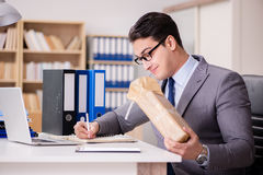 The businessman receiving parcel in the office Stock Image