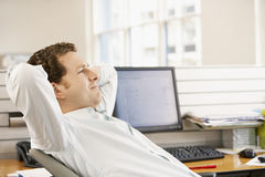 Businessman Reclining In Office Chair Stock Photos