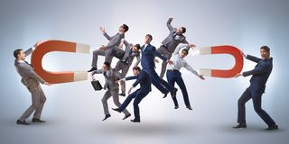 The businessman in recruitment concept with horseshoe magnet royalty free stock photos