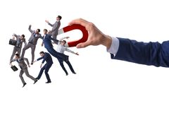 The businessman in recruitment concept with horseshoe magnet stock photography