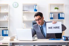 The businessman in recruitment concept in the office stock images