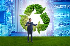 The businessman in recycling ecological concept. Businessman in recycling ecological concept royalty free stock photography