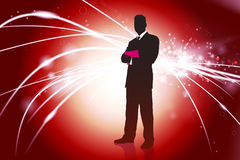 Businessman on Red Abstract Light Background.  Royalty Free Stock Photo