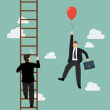 Businessman with red balloon fly pass businessman climbing the ladder. Royalty Free Stock Images