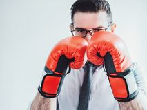 Businessman and red boxing gloves royalty free stock photo