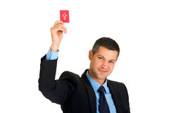 Businessman with a red card Royalty Free Stock Photos