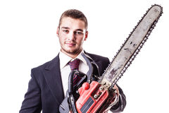 Businessman with red chain saw. A young businessman holding a red chainsaw isolated over a white background Royalty Free Stock Photo