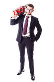 Businessman with red chainsaw Royalty Free Stock Photos