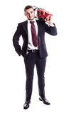 Businessman with a red chainsaw Royalty Free Stock Photos