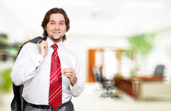 Businessman with red clipboard in office Stock Photo