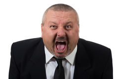 Businessman is red faced and very angry Stock Images