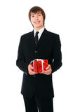 Businessman with the red gift Royalty Free Stock Image