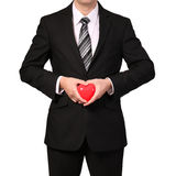 Businessman with red heart isolated on white. Valentine's Day Royalty Free Stock Photography