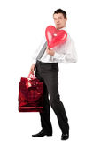 Businessman with red heart-like balloon Stock Photography