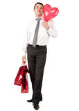 Businessman with red heart-like balloon Stock Image