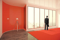 Businessman in red interior. Businessman with briefcase standing in bright red interior with floor lamp, window with city view and daylight. 3D Rendering Royalty Free Stock Photography