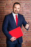 Businessman with a red pack offers to take a pen Royalty Free Stock Photography
