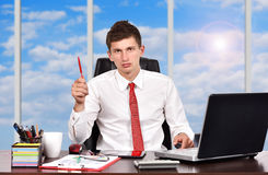 Businessman with Red Pen Stock Image