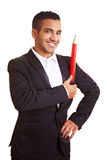 Businessman with red pencil Stock Images