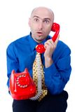 Businessman on a red phone Royalty Free Stock Photography