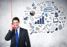 Businessman on the Red Phone. With Economics trend Royalty Free Stock Image