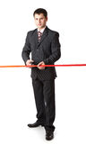 Businessman and red ribbon Stock Image