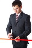 Businessman and red ribbon Stock Photography