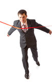 Businessman and red ribbon Royalty Free Stock Images