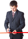 Businessman and red ribbon Royalty Free Stock Image